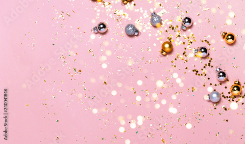 Fotografie, Obraz  Christmas background with golden decorations put as frame on pink pink background