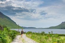 A Woman Hiker Walking Towards The Wast Water , England's Deepest Lake In Cumbria, UK