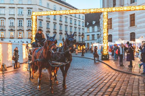 Hackney cab on Christmas market at Hofburg Palace in Vienna Canvas Print