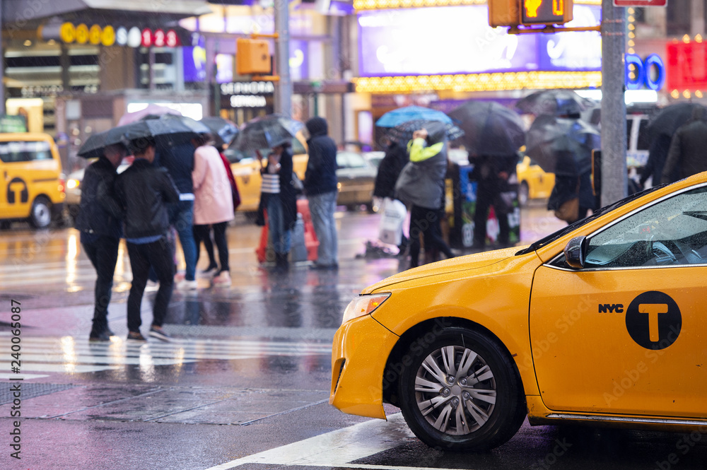 Fototapety, obrazy: Yellow cab speeds through Times Square, the busy tourist intersection of neon art and commerce.