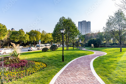 Wall Murals Blue sky modern building and beautiful park, china