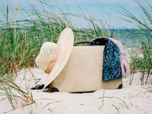 Vintage Suitcase, Summer Hat, And A Retro Camera At Sea