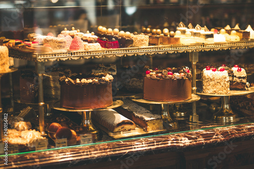 Fotografiet Pastry shop display window with variety of cakes
