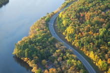 Aerial View Of Curving Road Along Mississippi River In Northern Minnesota During Autumn