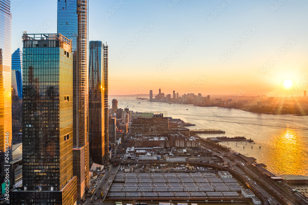 Fototapety, obrazy: Aerial New York City waterfront skyline at sunset viewed from Hudson Yards towards Jersey City accross Hudson River.