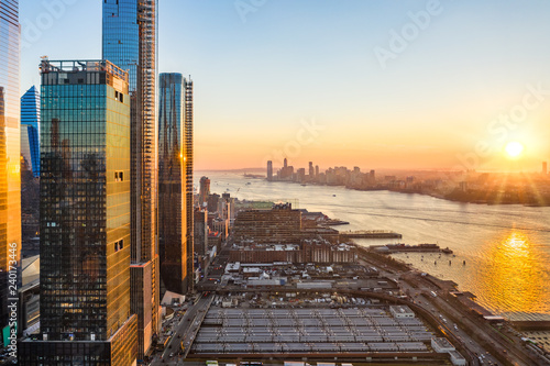 Poster New York Aerial New York City waterfront skyline at sunset viewed from Hudson Yards towards Jersey City accross Hudson River.