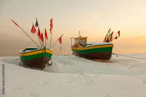 Podmorskie region, Poland - December, 2010: fishing boats on frozen beach, Baltic sea near Sopot town