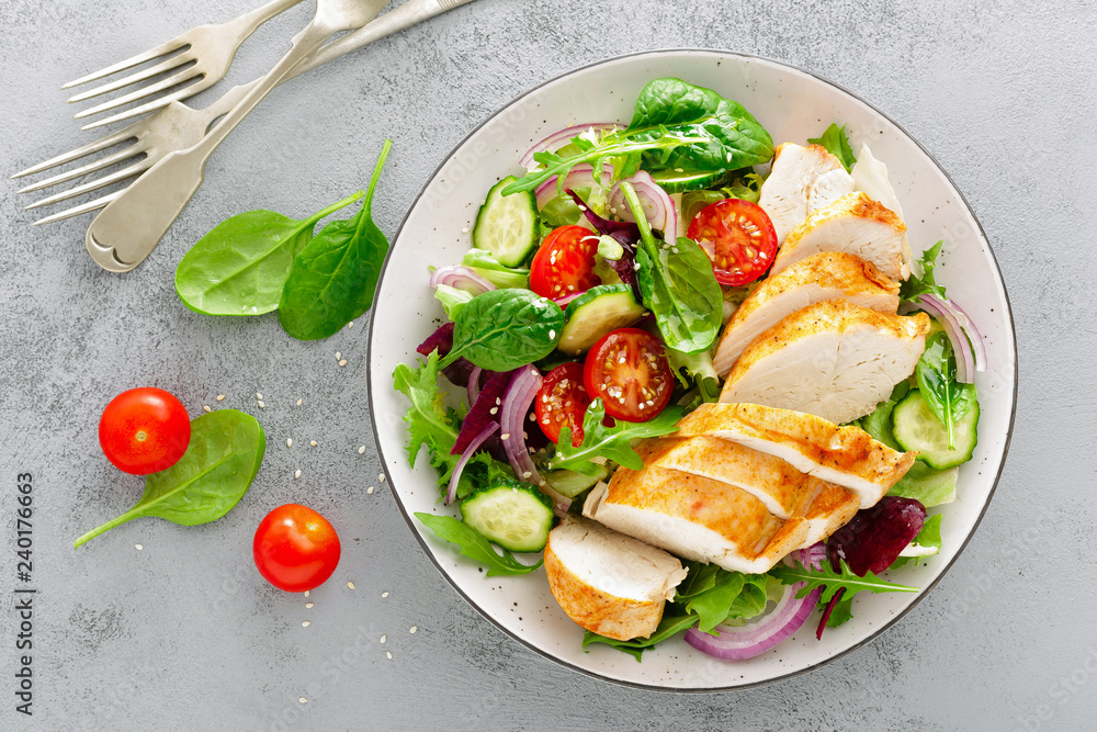 Fototapety, obrazy: Grilled chicken breast, fillet and fresh vegetable salad of lettuce, arugula, spinach, cucumber and tomato. Healthy lunch menu. Diet food. Top view