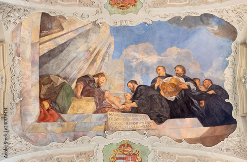 PRAGUE, CZECH REPUBLIC - OCTOBER 12, 2018: The baroque symbolic ceilinig fresco of St. Augustine washed the feet of Jesus in church kostel Svatého Tomáše by Václav Vavřinec Reiner (1689 - 1743).