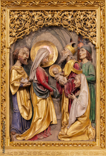 PRAGUE, CZECH REPUBLIC - OCTOBER 14, 2018: The gothic polychorme carved relief of Presentation of Jesus in the Temple in St. Vitus cathedral