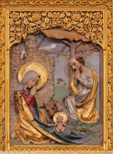PRAGUE, CZECH REPUBLIC - OCTOBER 14, 2018: The gothic polychorme carved relief Nativity of in St. Vitus cathedral by