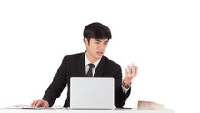 A Handsome Businessman Crunched Report With Displeased Emotion Face. A Young CEO Furious With Mistake Report. Business Man Hand Crunching A Piece Of White Paper In Anger On White Background.