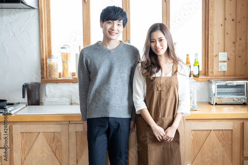 young asian couple in kitchen