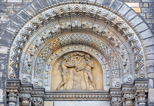 Valokuva PRAGUE, CZECH REPUBLIC - OCTOBER 17, 2018: The relief of Adam and Eva (Paradise Lost) on the portal of the church kostel Svatého Cyrila Metodeje by Václav Levý (1867 - 1869)