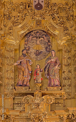 CORDOBA, SPAIN - MAY 26, 2015: The carved Holy Family sculptural group on the main altar in church of Monastery of st. Ann and st.Joseph (Convento de Santa Ana y San Jose) by Sanchez de Rueda (1710).