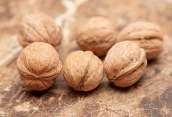 Walnuts on a marble table on the table