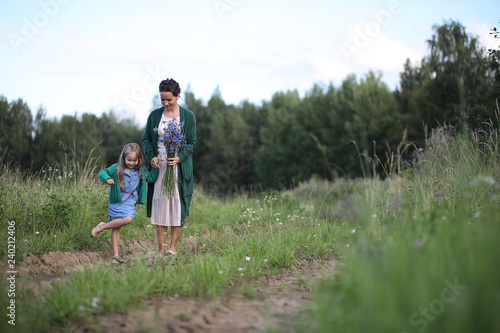 Fotografia, Obraz  Mother with daughter walking on a road
