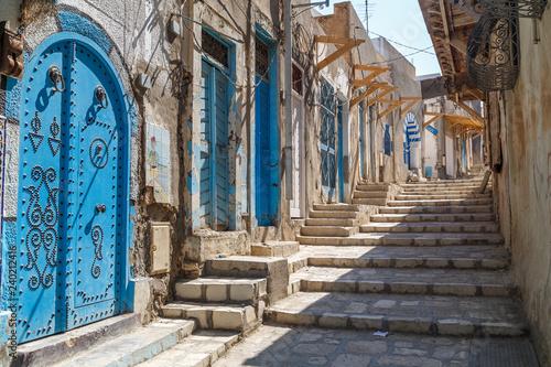 Fototapety, obrazy: SOUSSE / TUNISIA - JUNE 2015: Typical street inside the medieval Sousse medina, Tunisia
