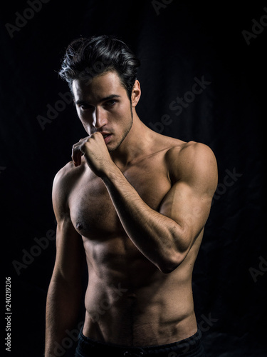 Fényképezés Handsome muscular shirtless young man standing confident, front view, looking at