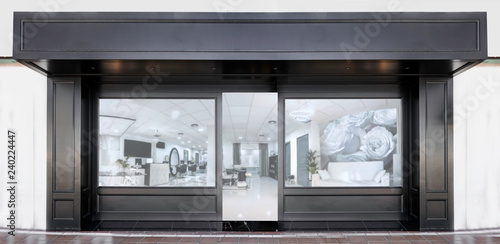 Fotografía  Outdoor mockup,store template,front view black of generic store facade with windows display and blanck posters
