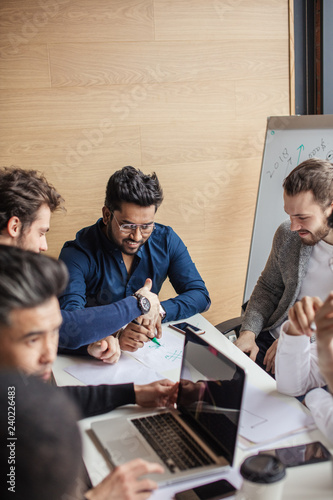 Fotografía  Male corporate team show activity at teambuilding with multiethnic colleagues, m