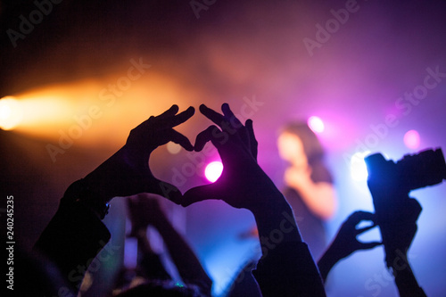 Concert in the club, the hands of the people in front of those lights Canvas Print