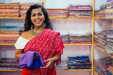 Business Lady In Red Traditional Sari And Jewelery Clothes Shop Owner Cashmere Yak Wool Shawls.female Seller In Goa India Arambol Sale Shop.designer Seamstress Tailor Girl Choosing Fabric