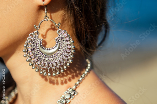 Canvas Print female model earrings and necklace in vacation on paradise tropical beach by ocean sea