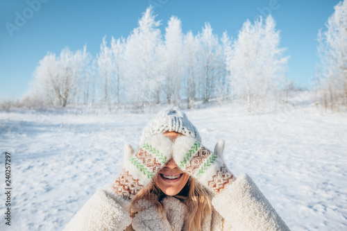 Woman in gloves in magic winter day