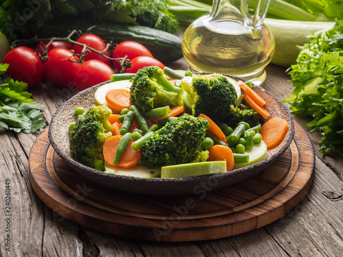 Photo Mix of boiled vegetables, steam vegetables for dietary low-calorie diet