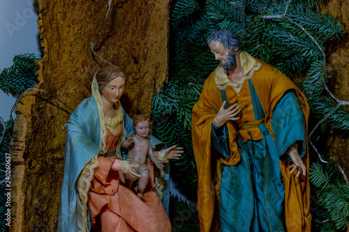 The representation of the holy family, The Virgin Mary holding the Child Jesus and beside St Wallpaper Mural