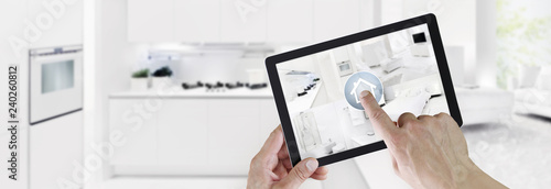 Fotografía  smart home control concept hand touch digital tablet screen with interiors, livi
