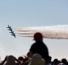 Silhouette Of Boy Watching Jets On His Parents Shoulder At The Miramar Airshow In San Diego
