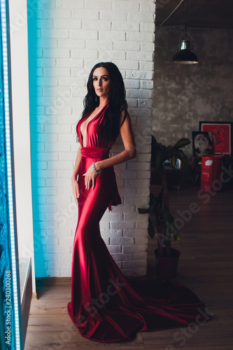 2ee5734ae54 fashion studio photo of gorgeous woman with dark hair and evening makeup