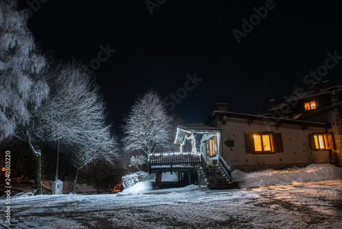 Photographie  lighted house at sunset