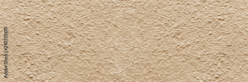 Valokuva  Panorama beige rough textured concrete background