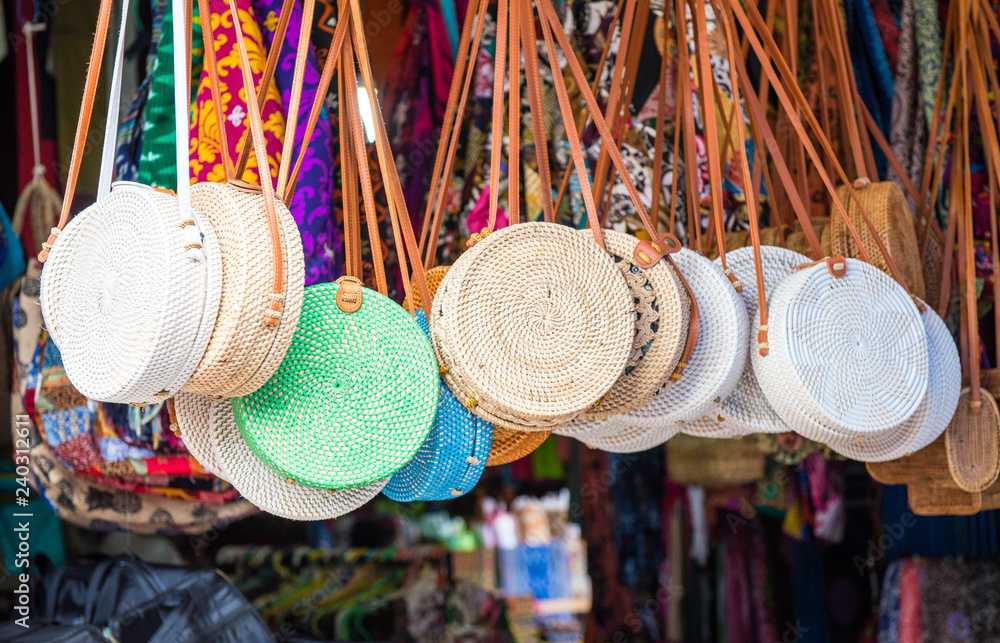 Fototapety, obrazy: Iconic rattan hand bags hanging for souvenir at a street shop in Ubud market of Bali island, Indonesia.