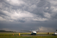 Storm Clouds Over The Airfield In The Countryside.