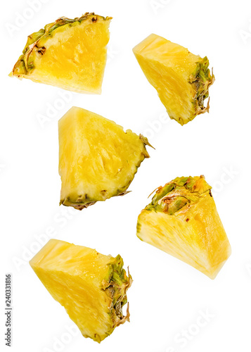 pineapple slices flying isolated on white with clipping path