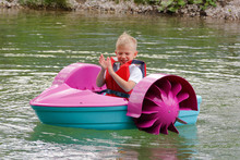 Baby Floats On A Toy Baby Boat. Attraction.