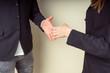 a hand shake in a team