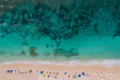 Top view of the beautiful beach with sun umbrellas and turquoise ocean water