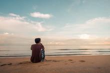 Lonely Asian  Man Sitting Watc...