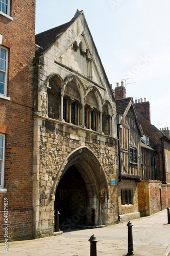 Fototapeta  Picturesque old buildings around St Marys Gate near Gloucester Cathedral in spring sunshine, Gloucestershire, UK