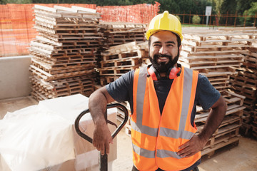 FototapetaHappy Hispanic Manual Worker With Forklift Smiling At Camera