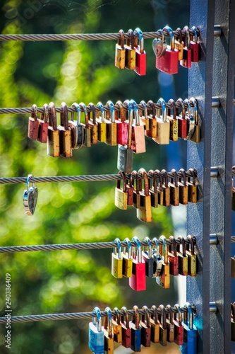 A love lock is a padlock attached to bridges, grids, according to a custom of lovers. This is to symbolically seal their eternal love. - 240386409