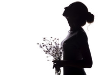 Silhouette Of A Girl With A Bouquet Of Dry Dandelions Looking Up, The Face Profile Of A Young Woman On A White Isolated Background,