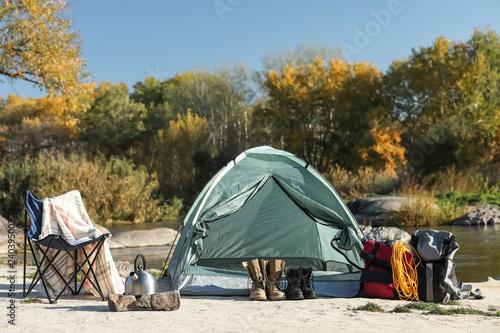 Fototapeta Set of equipment near camping tent outdoors obraz