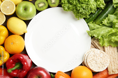 Flat lay composition with healthy food and empty plate, space for text. Concept of weight loss