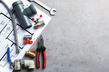 Flat Lay Composition With Plumber's Tools And Space For Text On Grey Background